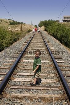 Little Boy on the Train Tracks