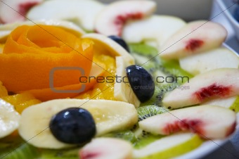 Fresh juicy fruit salad on a plate