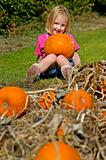 Little Girl Holding Pumpkin