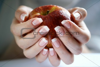 An Apple in a female hands