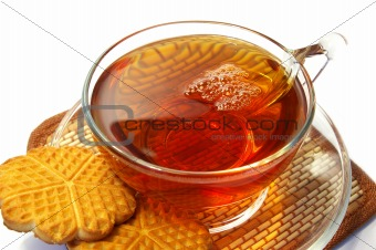 Transparent cup of tea and cookies