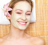Smiling beautiful woman with face mask