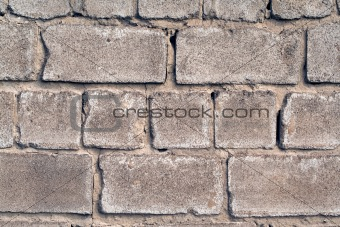 old wall from a rough grey brick. background 1