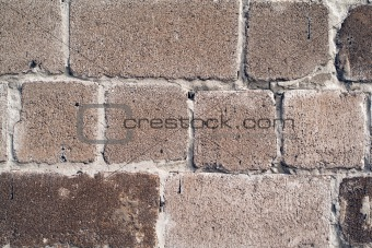 old wall from a rough grey brick. background 2