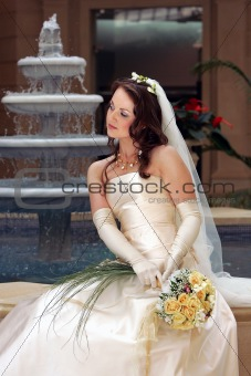Smiling bride in white wedding dress