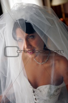 Smiling bride in white wedding dress