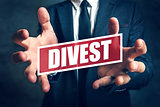 Divestment concept with businessman in suite