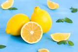 Lemon on the blue wood table with mint