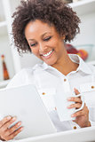 Mixed Race African American Girl Tablet Computer and Coffee