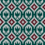 Knitting ornate seamless pattern in red, green and white colors