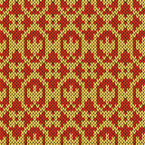 Knitting ornate seamless pattern in hues of orange
