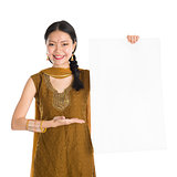 Punjabi female holding blank white paper card.