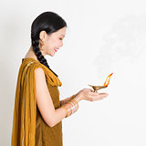 Girl holding diya light