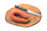 Chorizo sausage on wooden cutting board
