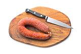 Chorizo sausage on wooden cutting board