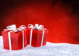Christmas gifts in snow on red background. 3D render.