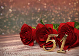 birthday concept with red roses on wooden desk. fifty-first . 51st. 3D render