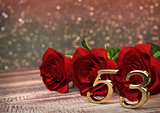 birthday concept with red roses on wooden desk. fifty-third . 53rd. 3D render