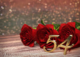birthday concept with red roses on wooden desk. fifty-fourth . 54th. 3D render