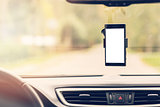 mobile phone with blank screen in car windshield holder