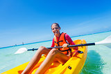 Girl paddling in kayak