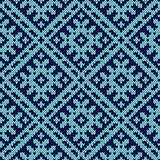 Knitting ornate seamless pattern in dark and light blue hues