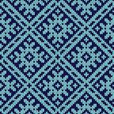 Knitting ornate seamless pattern in dark and light blue hues