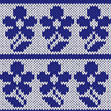 Knitting ornate seamless colourful pattern with dark blue flower