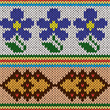 Knitting ornate seamless colourful pattern with blue flowers