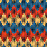 Knitting ornate seamless pattern with geometric color figures
