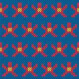 Knitting ornate seamless pattern with geometric figures over blu