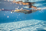 Swimmer in crawl style underwater