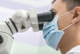 Dentist using a dental microscope