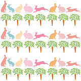 rabbits and carrots on a white background