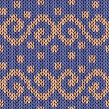 Knitting seamless ornate pattern with swirl elements