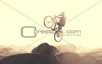 Cyclist climbing on a rock.