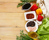 herbs and spices, vegetables and sauces on wooden background