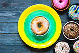 Colorful Donuts breakfast composition with different color styles