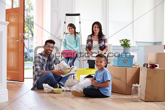 Portrait Of Hispanic Family Moving Into New Home