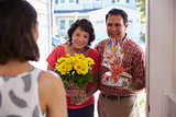 Parents Visiting Hispanic Daughter In New Home