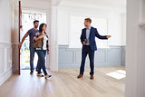 Realtor Showing Hispanic Couple Around New Home