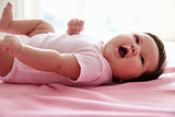 Cute Baby Girl Laying On Pink Blanket