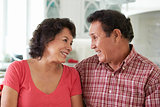 Head And Shoulders Shot Of Senior Hispanic Couple At Home