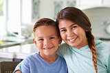 Head And Shoulders Portrait Of Hispanic Children At Home