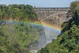 Close-up of Victoria Falls Bridge over rainbow