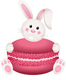 Cute bunny holding macaroon