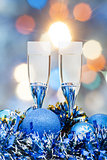 glasses, blue Xmass balls on blurry background 2