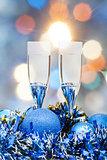 glasses, blue Xmass balls on blurry background 2