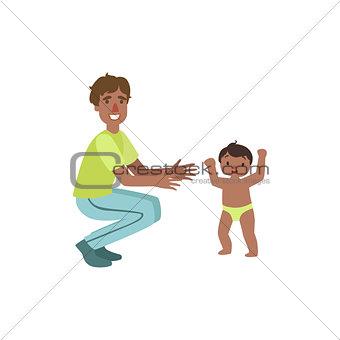 Dad Crouching To Catch Walking Toddler