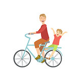 Father Riding A Bicycle With His Kid On The Back